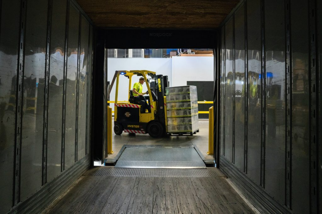 A forklift driver moving material